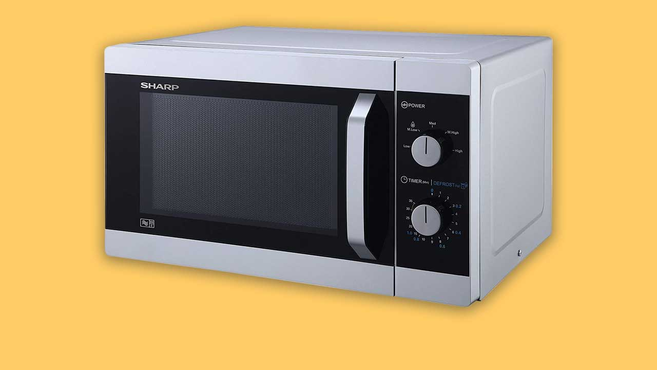 Easy to use microwave with two dials and a pull push door. Silver & black. Recommended UK