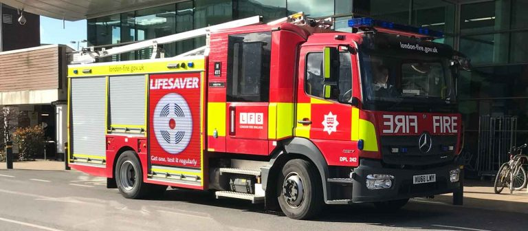 fire engine promoting smoke alarms for uk homes. lifesaver get one test it regularly